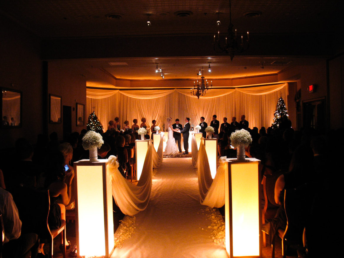 Elegant_Event_Lighting_Chicago_Herrington_Inn_Geneva_Wedding_Ceremony_Ivory_Draping_Amber_Uplighting_Flower_Pedestals