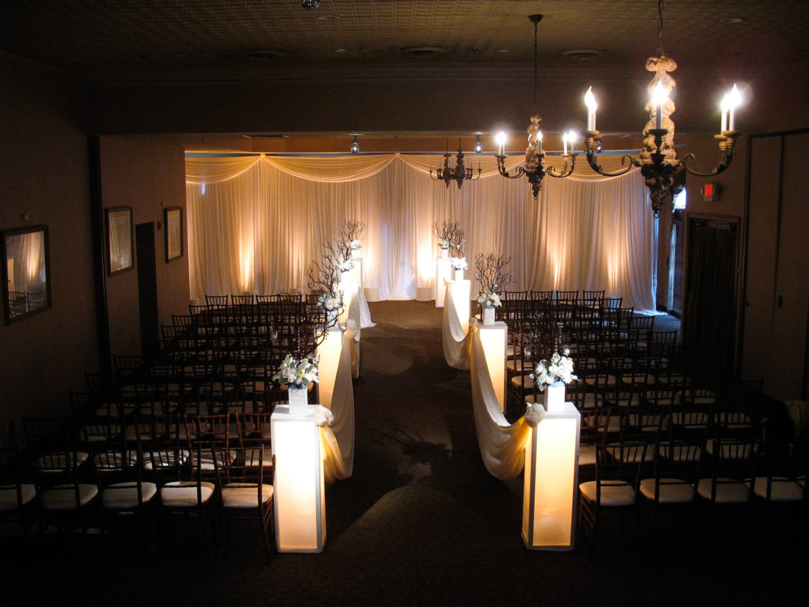 Elegant_Event_Lighting_Chicago_Herrington_Inn_Geneva_Wedding_Ivory_Draping_Ceremony_Flower_Pedestals
