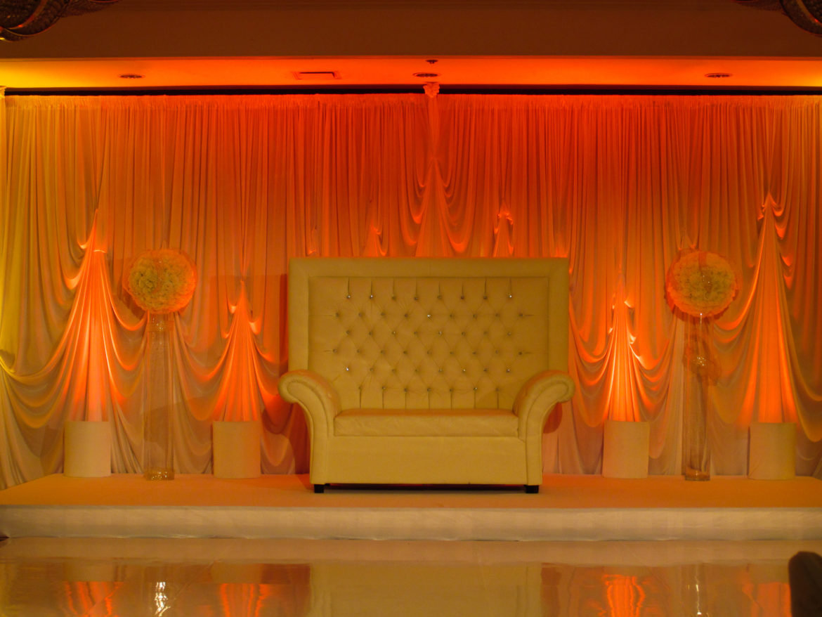 Elegant_Event_Lighting_Chicago_Hilton_Lisle_Naperville_Wedding_Ivory_Loveseat_Red_LED_uplighting_Draping_Backdrop