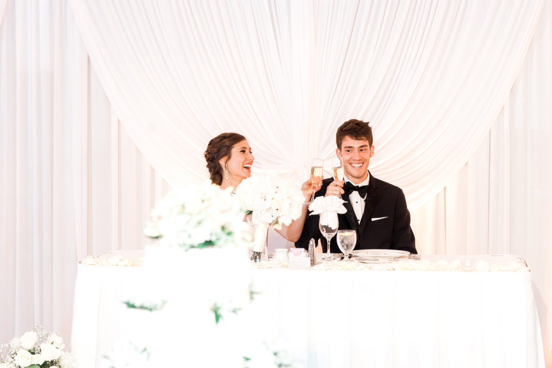 Elegant_Event_Lighting_Chicago_Hilton_Lisle_Naperville_Wedding_White_Draping_Backdrop_Head_Table_Uplighting_Toast