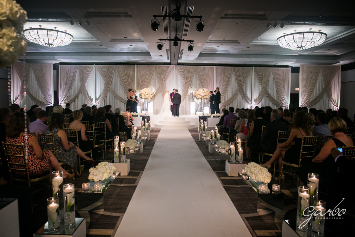 Elegant_Event_Lighting_Chicago_Hilton_Oak_Brook_Wedding_Ceremony_Vows_Stage_Cover_Moon_Steps_Aisle_Runer_Backdrop_Silver_Ivory