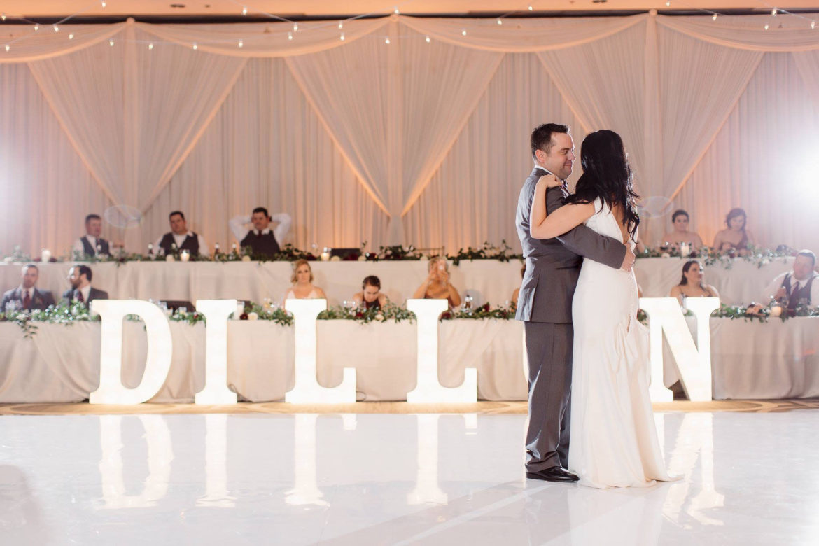 Elegant_Event_Lighting_Chicago_Hilton_Oak_Brook_Wedding_Marquee_Letters_Backdrop_Ivory_Draping_Amber-Uplighting_First_Dance