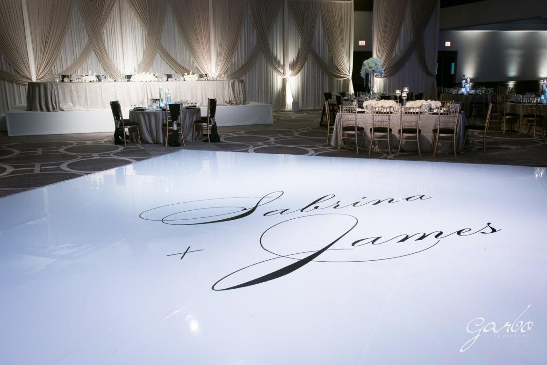 Elegant_Event_Lighting_Chicago_Hilton_Oak_Brook_Wedding_White_Dance_Floor_Cover_Monogram_Backdrop_Reception