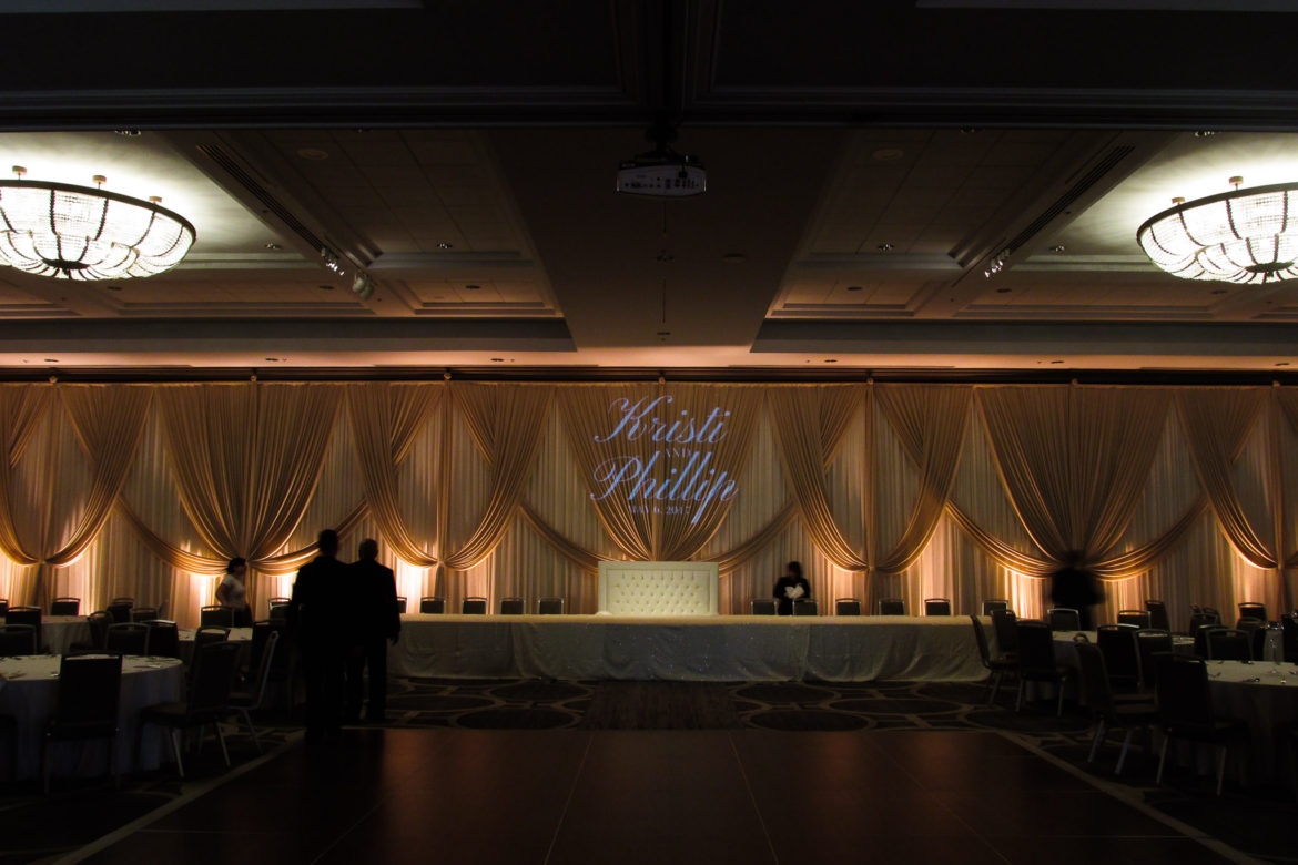 Elegant_Event_Lighting_Chicago_Hilton_Oak_brook_Wedding_Champaign_Ivory_Backdrop_Monogram_Loveseat_Spotlight