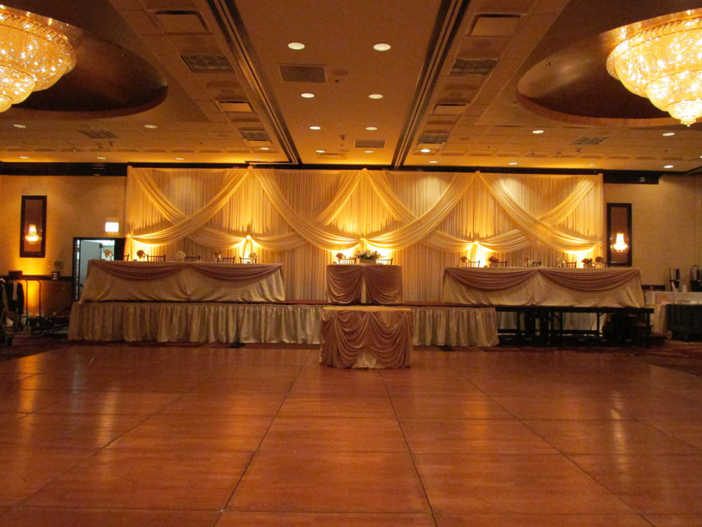 Elegant_Event_Lighting_Chicago_Holiday_Inn_Skokie_Wedding_Ivory_Draping_Amber_LED_Uplighting_Backdrop
