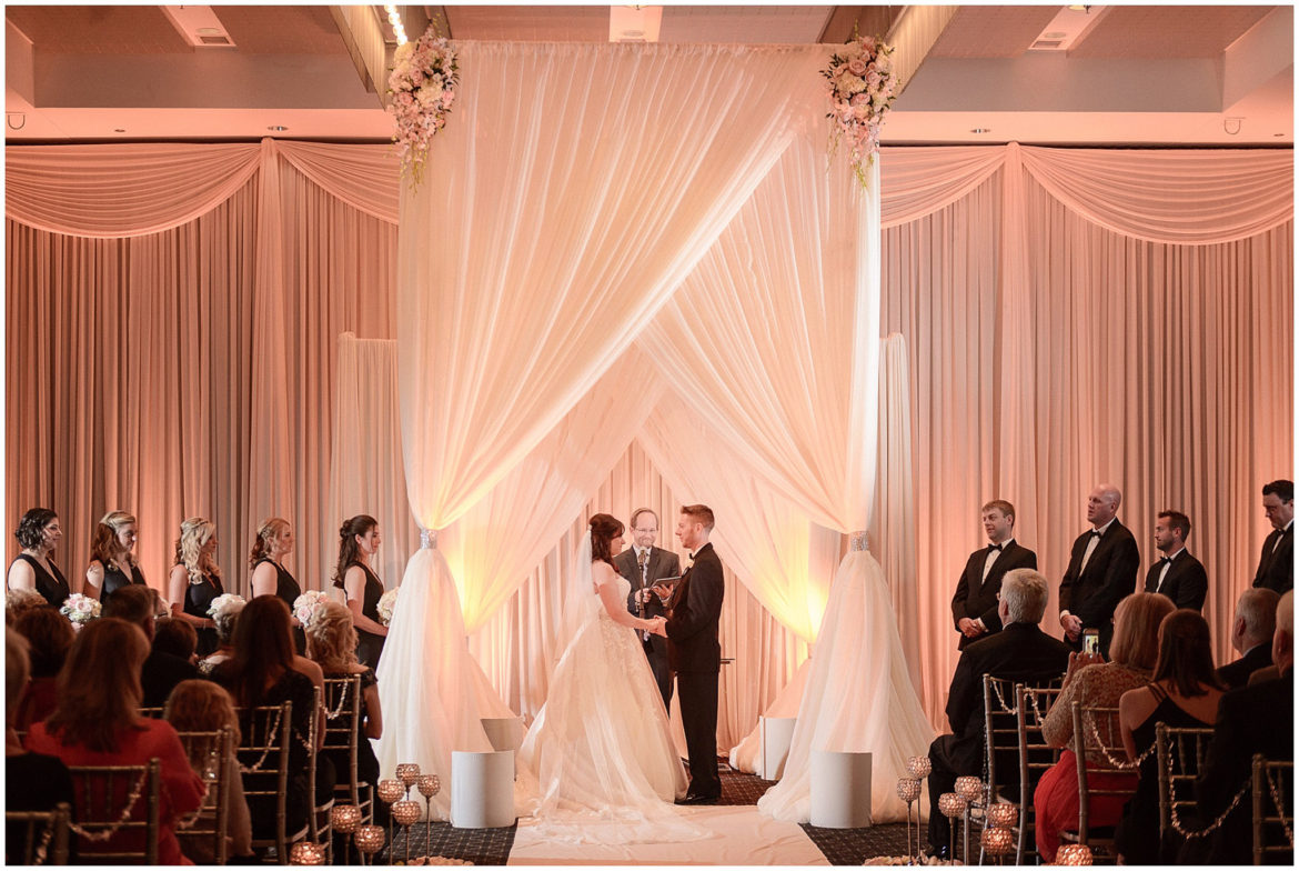 Elegant_Event_Lighting_Chicago_Hotel_Arista_Naperville_Wedding_Ivory_Draping_Amber_Uplighting_Backdrop_Flowers