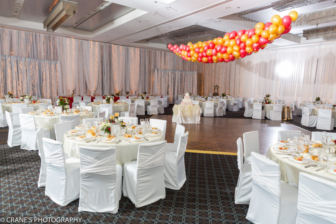 Elegant_Event_Lighting_Chicago_Hotel_Arista_Naperville_Wedding_Twinkle_Lights_Room_Draping_New_Year_Eve_Balloon_Drop_Red_Gold