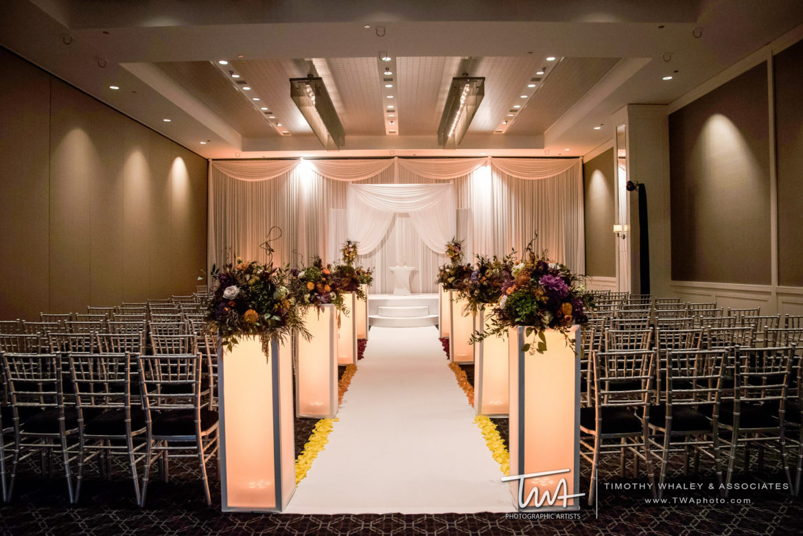 Elegant_Event_Lighting_Chicago_Hotel_Arista_Naperville_Wedding_White_Bridal_Arch_Ceremony_Flower_Pedestal_Aisle_Runner