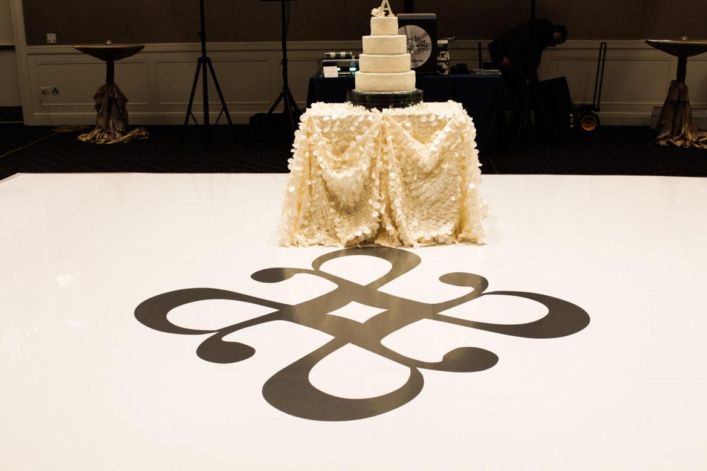 Elegant_Event_Lighting_Chicago_Hotel_Arista_Naperville_Wedding_White_Dance_Floor_Vinyl_Cover_Gold_Monogram