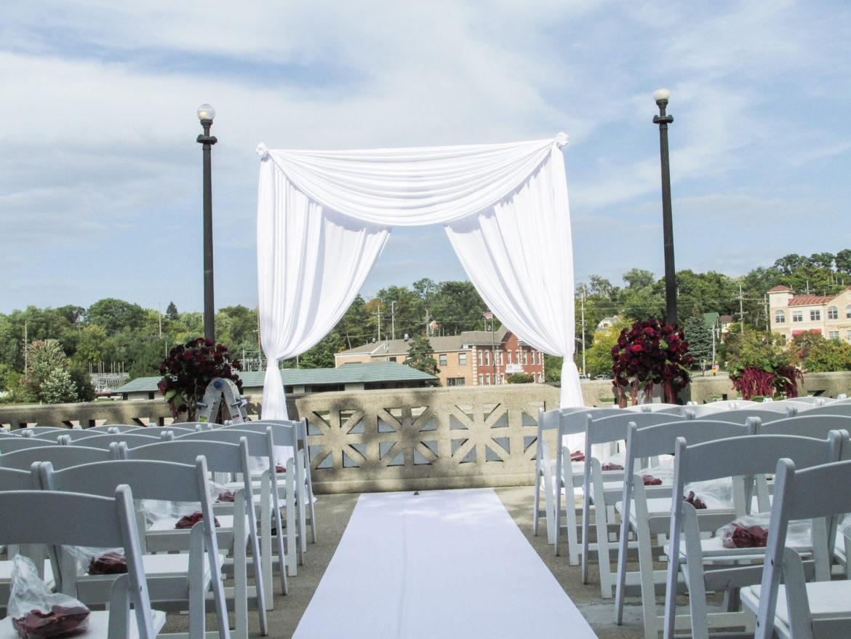 Elegant_Event_Lighting_Chicago_Hotel_Baker_St_Charles_Wedding_Arch_Outdoor_Ceremony_Aisle_Runner