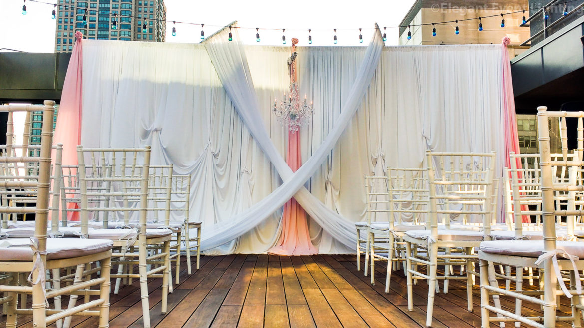 Elegant_Event_Lighting_Chicago_Hotel_Cambria_Wedding_Pink_White_Backdrop_Draping_Pickup_Criss-cross-Chandelier