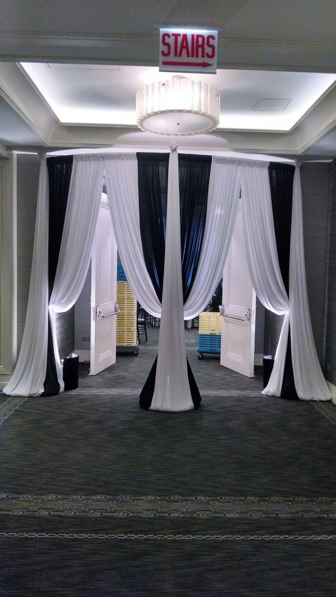 Elegant_Event_Lighting_Chicago_Hotel_Palomar_Wedding_White_Black_Draping_Curve_Entrance
