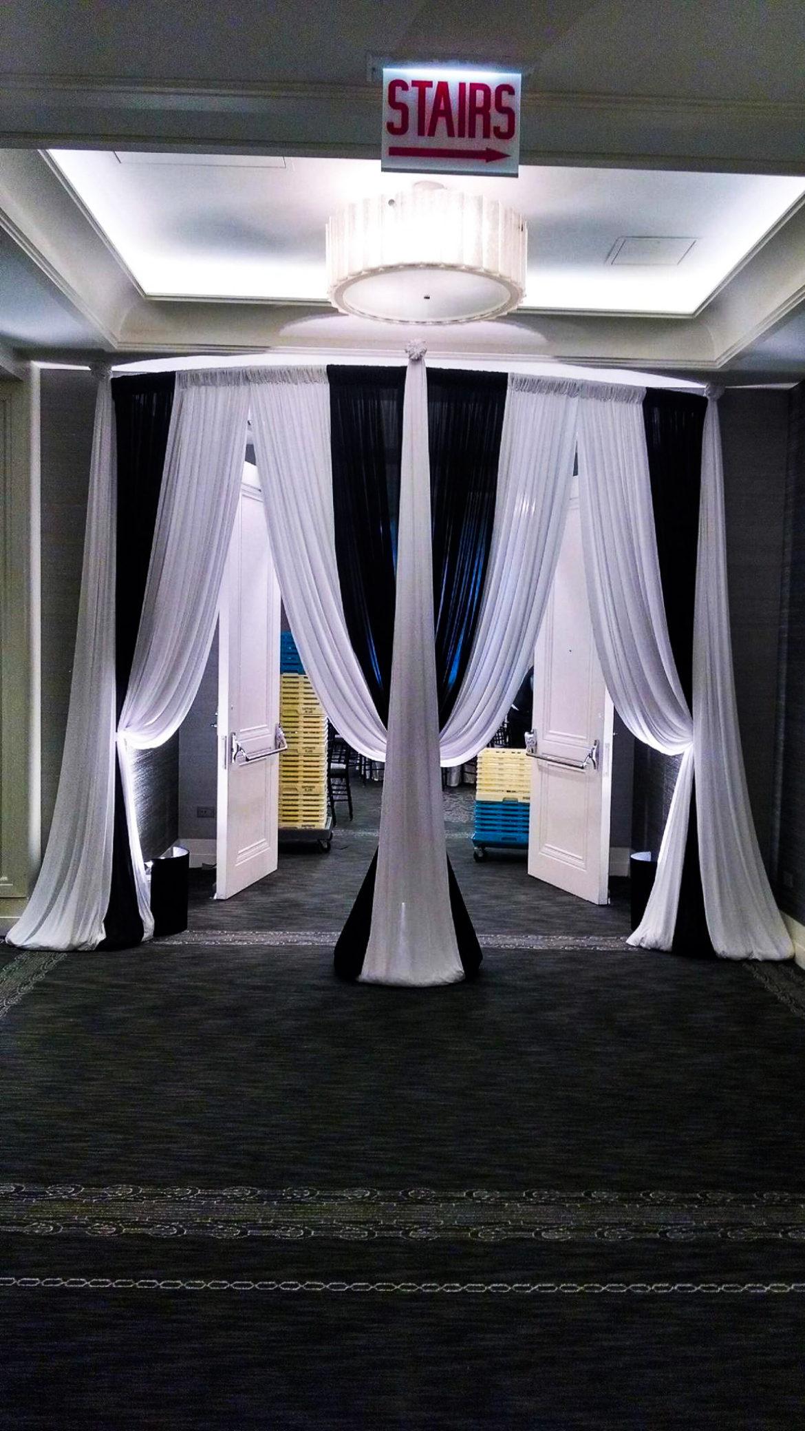 Elegant_Event_Lighting_Chicago_Hotel_Palomar_Wedding_White_Black_Entrance_Draping