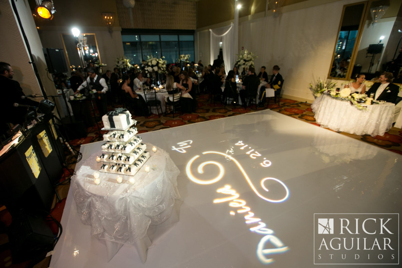 Elegant_Event_Lighting_Chicago_Hotel_Palomar_Wedding_White_Dance_Floor_Vinyl_Monogram_Spotlight