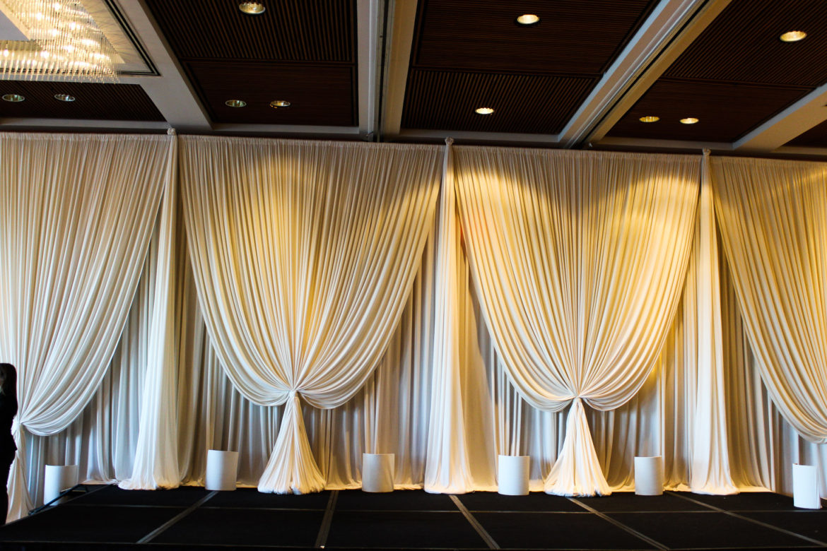 Elegant_Event_Lighting_Chicago_Hyatt_Lodge_Oak_Brook_Wedding_Ivory_Backdrop_Amber_Uplighting