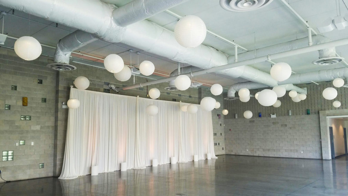 Elegant_Event_Lighting_Chicago_Ignite_Glass_Studios_Wedding_Ivory_Draping_Backdrop_White_Paper_Lanterns