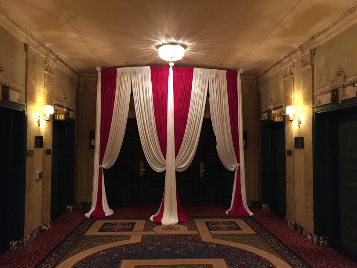 Elegant_Event_Lighting_Chicago_Intercontinental_Chicago_Grand_Ballroom_Wedding_Entrance_Red_White_Drape