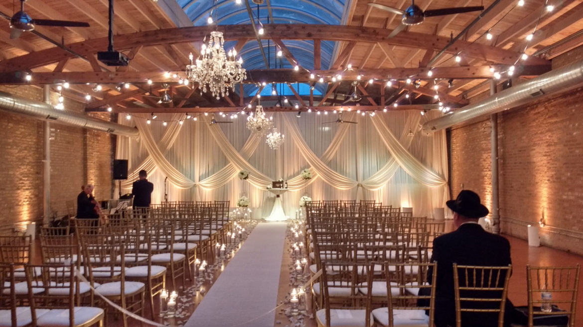 Elegant_Event_Lighting_Chicago_Loft_On Lake_Wedding_Ivory_Fabric_Backdrop_Chandelier_Ceremony