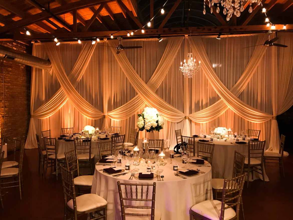 Elegant_Event_Lighting_Chicago_Loft_On_Lake_Wedding_Uplighting_Ivory_Backdrop_Draping_Cafe_Globe_Lights_Crystal_Chandeliers_Flower
