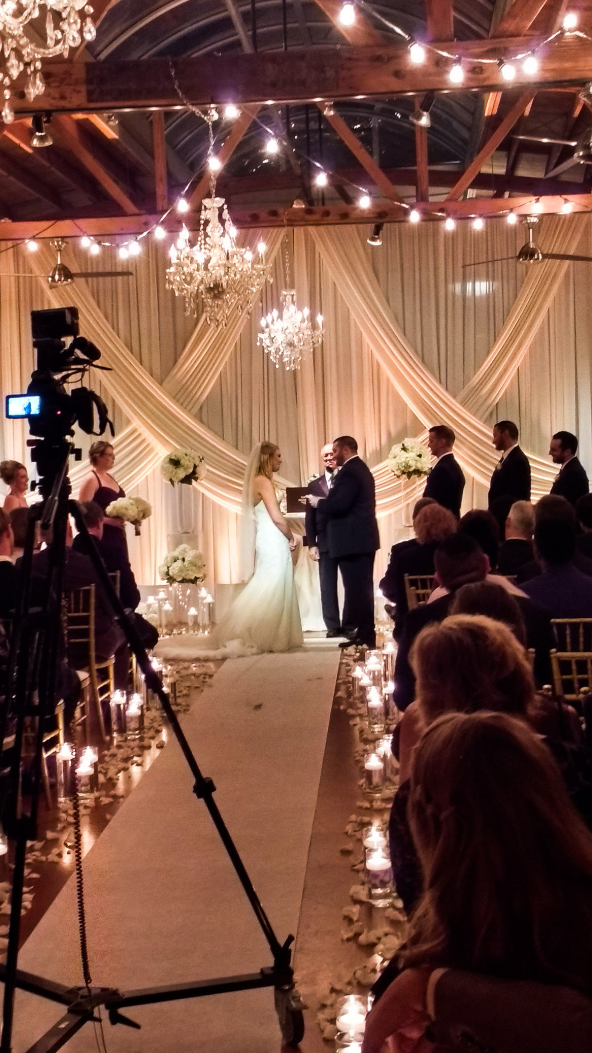 Elegant_Event_Lighting_Chicago_Loft_On_Lake_Wedding_Uplighting_Ivory_Backdrop_Draping_Cafe_Globe_Lights_Crystal_Chandeliers_Flower_Ceremony_Aisle_Runner_Romantic