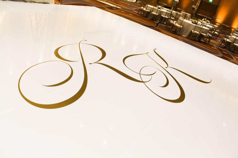 Elegant_Event_Lighting_Chicago_MGM_Detroit_Wedding_White_Vinyl_Dance_Floor_Gold_Monogram