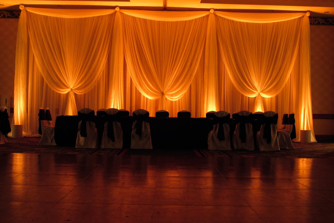 Elegant_Event_Lighting_Chicago_Mariott_Burr_Ridge_Burr_Ridge_Wedding_Amber_Uplighting_Ivory_Backdrop_Draping