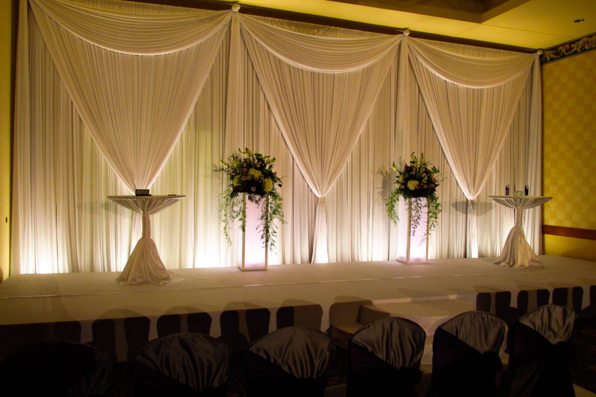 Elegant_Event_Lighting_Chicago_Mariott_Burr_Ridge_Burr_Ridge_Wedding_Uplighting_Ivory_Backdrop_Draping_Flower_Pedestal_Stage_Cover