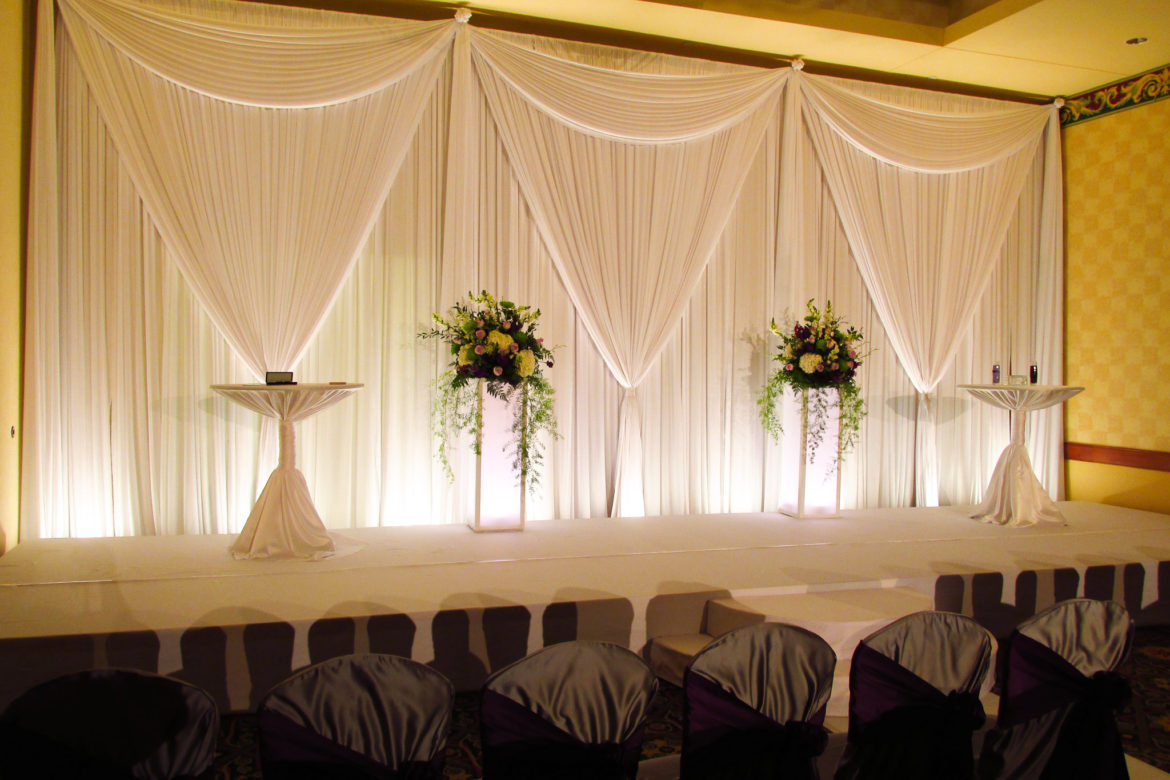 Elegant_Event_Lighting_Chicago_Mariott_Burr_Ridge_Burr_Ridge_Wedding_Uplighting_White_Backdrop_Draping_Flower_Pedestal_Stage_Cover