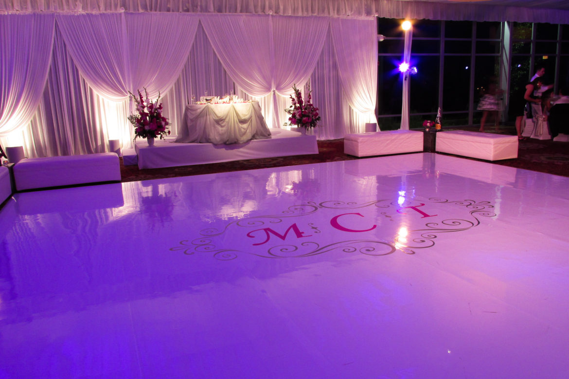 Elegant_Event_Lighting_Chicago_Mariott_Lincolnshire_Lincolnshire_Wedding_Uplighting_White_Backdrop_Draping_White_Vinyl_Dance_Floor_Monogram_Flower