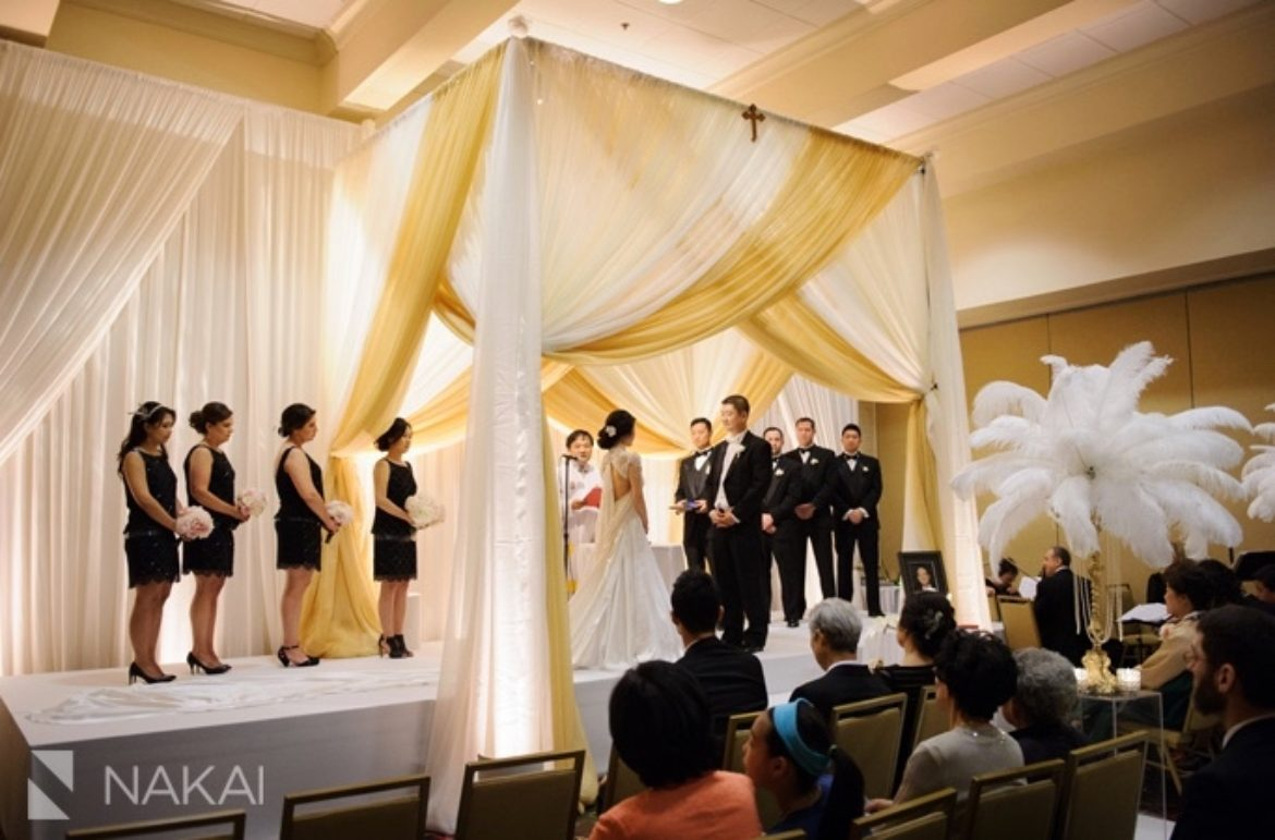 Elegant_Event_Lighting_Chicago_Marriot_Lincolnshire_Wedding_Uplighting_Bridal_Canopy_Chuppah_Gold_Fleather_Stage_cover_Moon_Steps