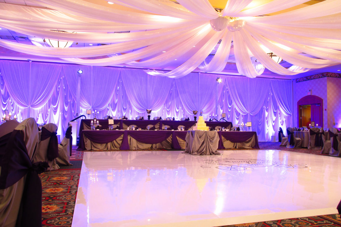 Elegant_Event_Lighting_Chicago_Marriott_Burr_Ridge_Burr_Ridge_Wedding_Purple_Uplighting_Backdrop_Ceiling_Drapes_White_Vinyl_Dance_Floor_Reception
