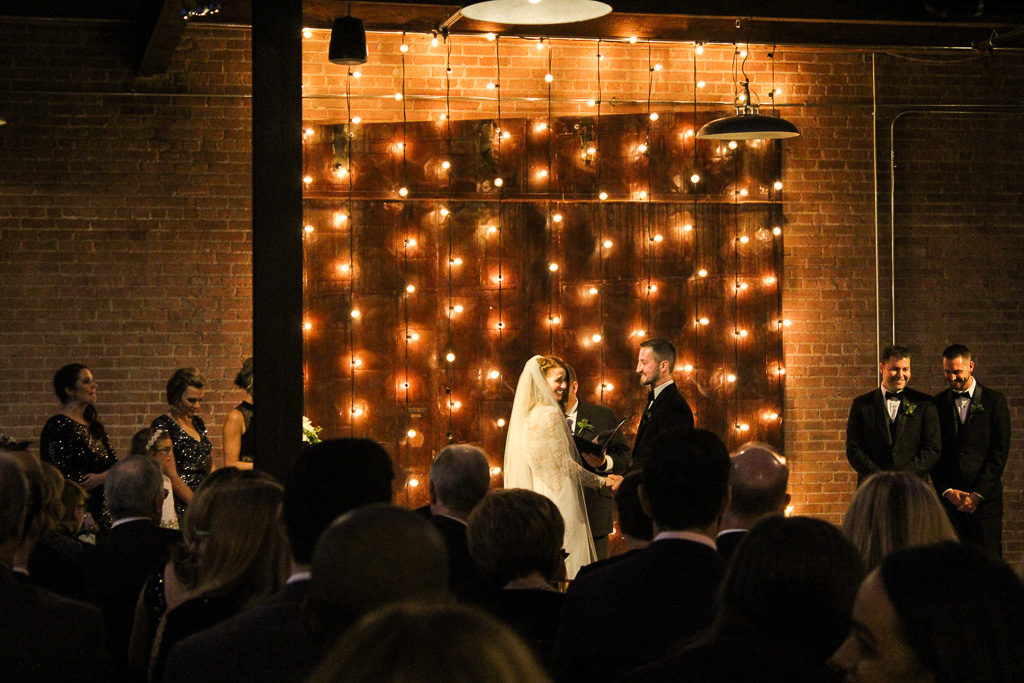Elegant_Event_Lighting_Chicago_Morgan_Manufacturing_Wedding_Ceremony_Cafe_Lights_Globe_String_Vertical_Backdrop