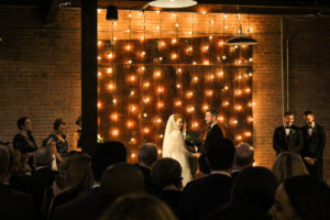 Elegant_Event_Lighting_Chicago_Morgan_Manufacturing_Wedding_Ceremony_Cafe_Lights_Globe_String_Vertical_Backdrop