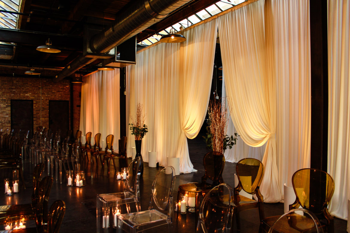 Elegant_Event_Lighting_Chicago_Morgan_Manufacturing_Wedding_Ceremony_Ivory_Draping_Amber_Uplighitng_Romantic