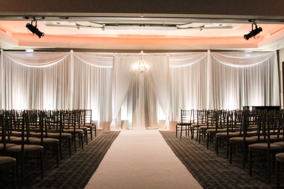 Elegant_Event_Lighting_Chicago_Park_Hyatt_Wedding_White_Backdrop_Draping_Chuppah_Bridal_Canopy_Arch_Crystal_Chandelier_Aisle_Runner
