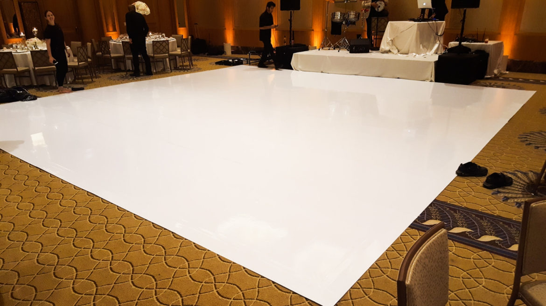 Elegant_Event_Lighting_Chicago_Peninsula_Hotel_Wedding_Uplighting_White_Vinyl_Dance_Floor