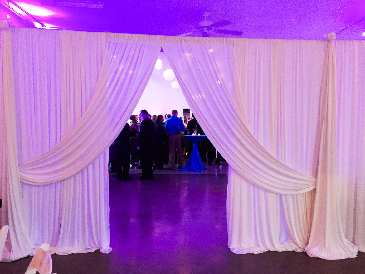 Elegant_Event_Lighting_Chicago_Prarie_Production_Wedding_Purple_Uplighting_Ivory_Backdrop_Draping_Drape_Opening