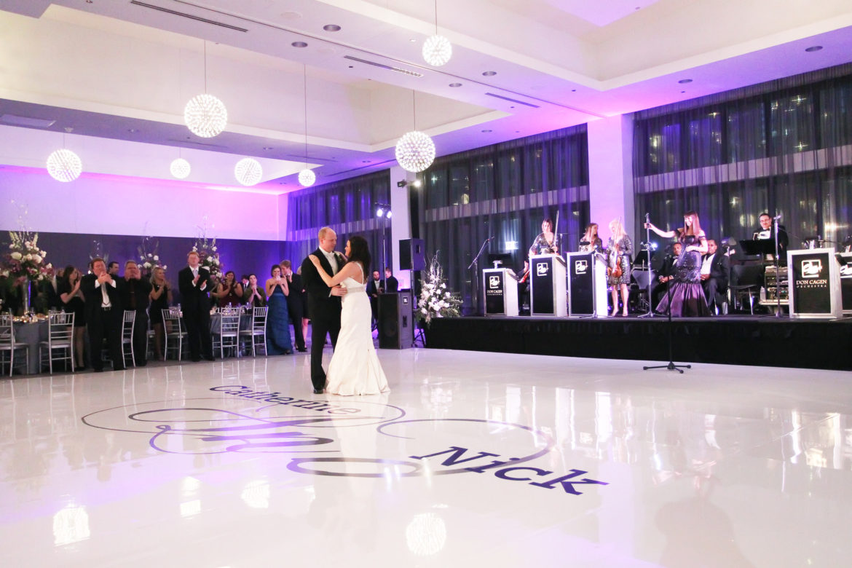 Elegant_Event_Lighting_Chicago_Raddison_Blu_Wedding_Purple_Uplighting_Reception_Lights_White_Vinyl_Dance_Floor_Monogram_First_dance_Flower_Stage_Lights