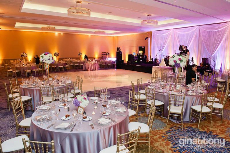Elegant_Event_Lighting_Chicago_Renaissance_Schaumburg_Wedding_Amber_Purple_LED_Uplighting_White_DAnce_Floor_BAckdrop
