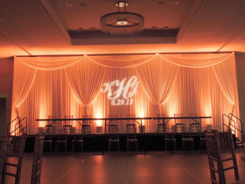 Elegant_Event_Lighting_Chicago_Renaissance_Schaumburg_Wedding_Uplighting_Amber_Ivory_Backdrop_Draping_Monogram