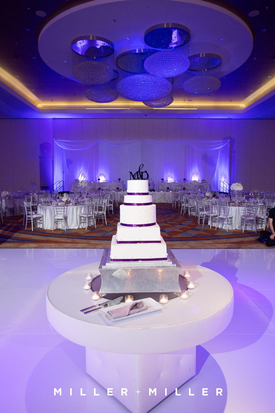 Elegant_Event_Lighting_Chicago_Renaissance_Schaumburg_Wedding_Uplighting_Purple_White_Backdrop_Draping_White_Vinyl_Dance_Floor_Flower
