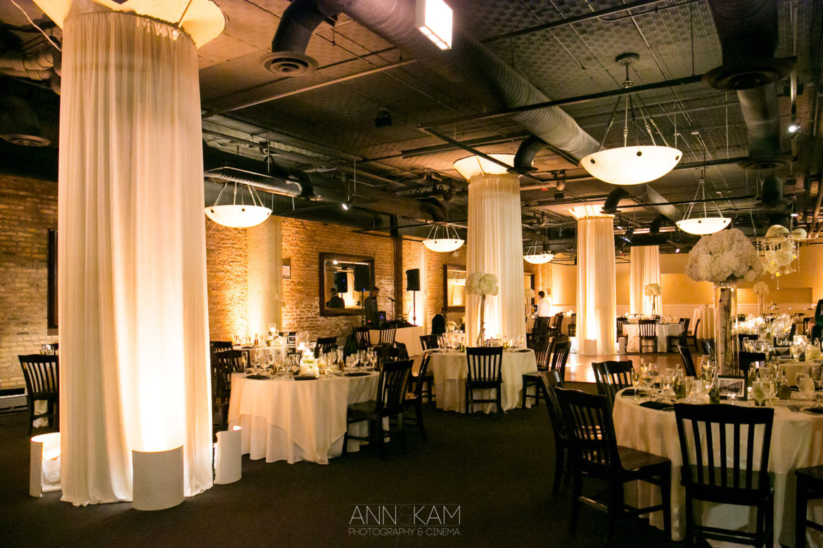 Elegant_Event_Lighting_Chicago_River_Roast_Wedding_Amber_Uplighting_Column_Lights_Draping_Flower.