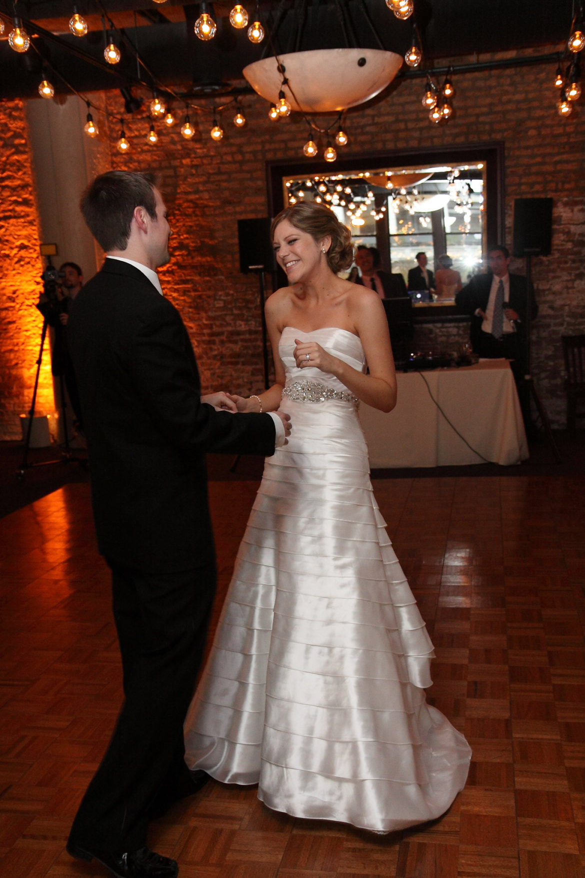 Elegant_Event_Lighting_Chicago_River_Roast_Wedding_Amber_Uplighting_Rustic_Cafe_Globe_Lighting_First_Dance