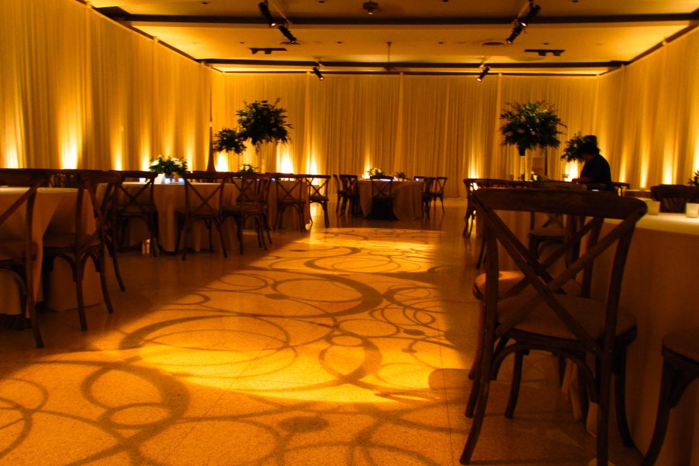 Elegant_Event_Lighting_Chicago_Saint_Demetrios_Wedding_Amber_Uplighting_Ivory_Backdrop_Room_Draping_Monogram