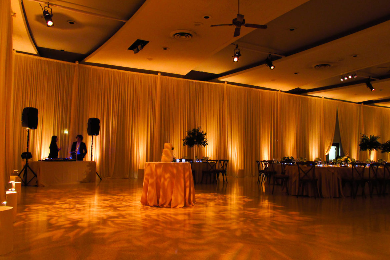 Elegant_Event_Lighting_Chicago_Saint_Demetrios_Wedding_Amber_Uplighting_Ivory_Backdrop_Room_Draping_Monogram_Pattern_Lighting