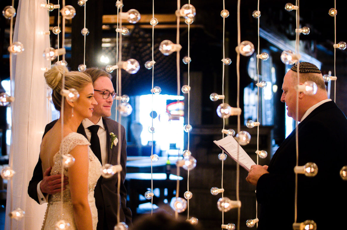 Elegant_Event_Lighting_Chicago_Salvage_One_Wedding_Bridal_Canopy_Chuppah_Cafe_Lights_Bride_Groom