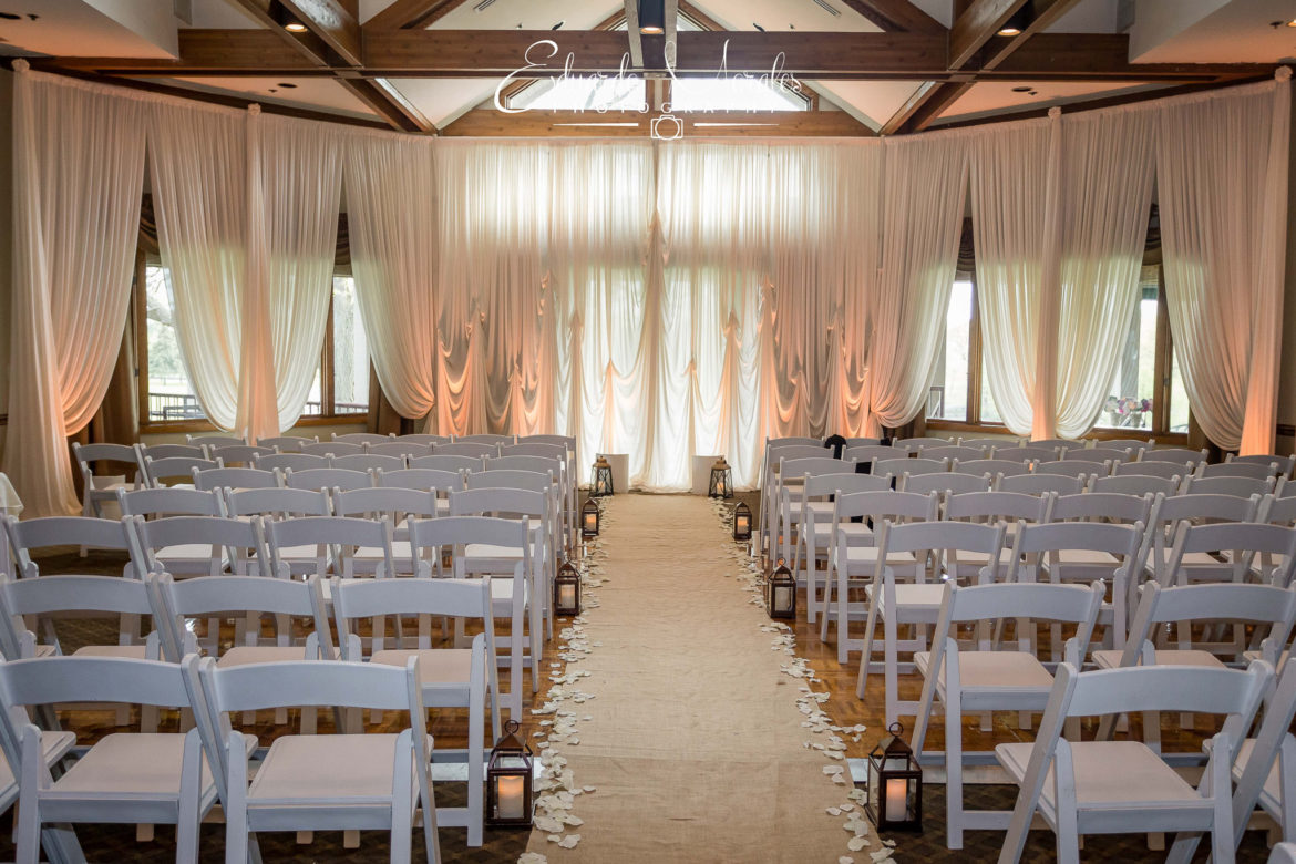 Elegant_Event_Lighting_Chicago_Seven_Bridges_Wedding_Amber_Uplighting_Ivory_Backdrop_Draping_Aisle_Runner
