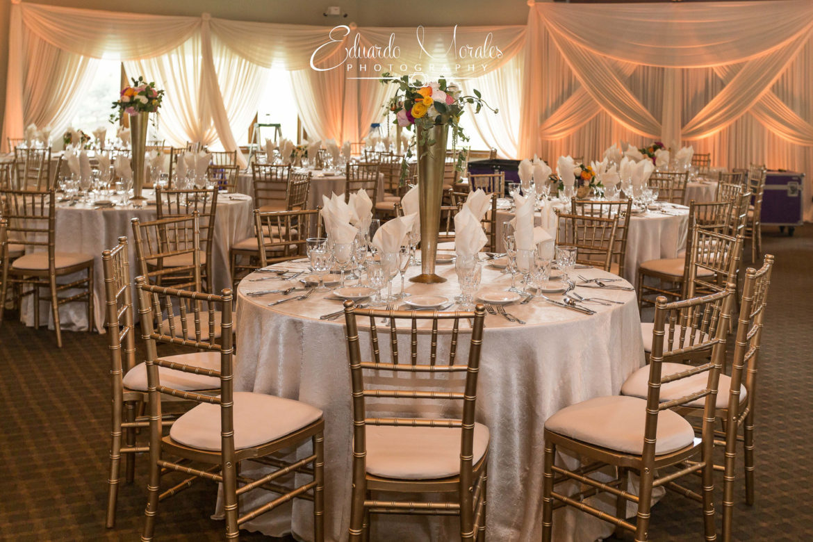 Elegant_Event_Lighting_Chicago_Seven_Bridges_Wedding_Amber_Uplighting_Ivory_Backdrop_Draping_Flower