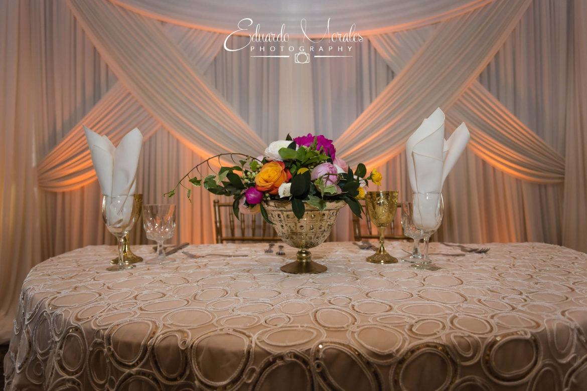 Elegant_Event_Lighting_Chicago_Seven_Bridges_Wedding_Amber_Uplighting_Ivory_Backdrop_Draping_Flower_Centerpice