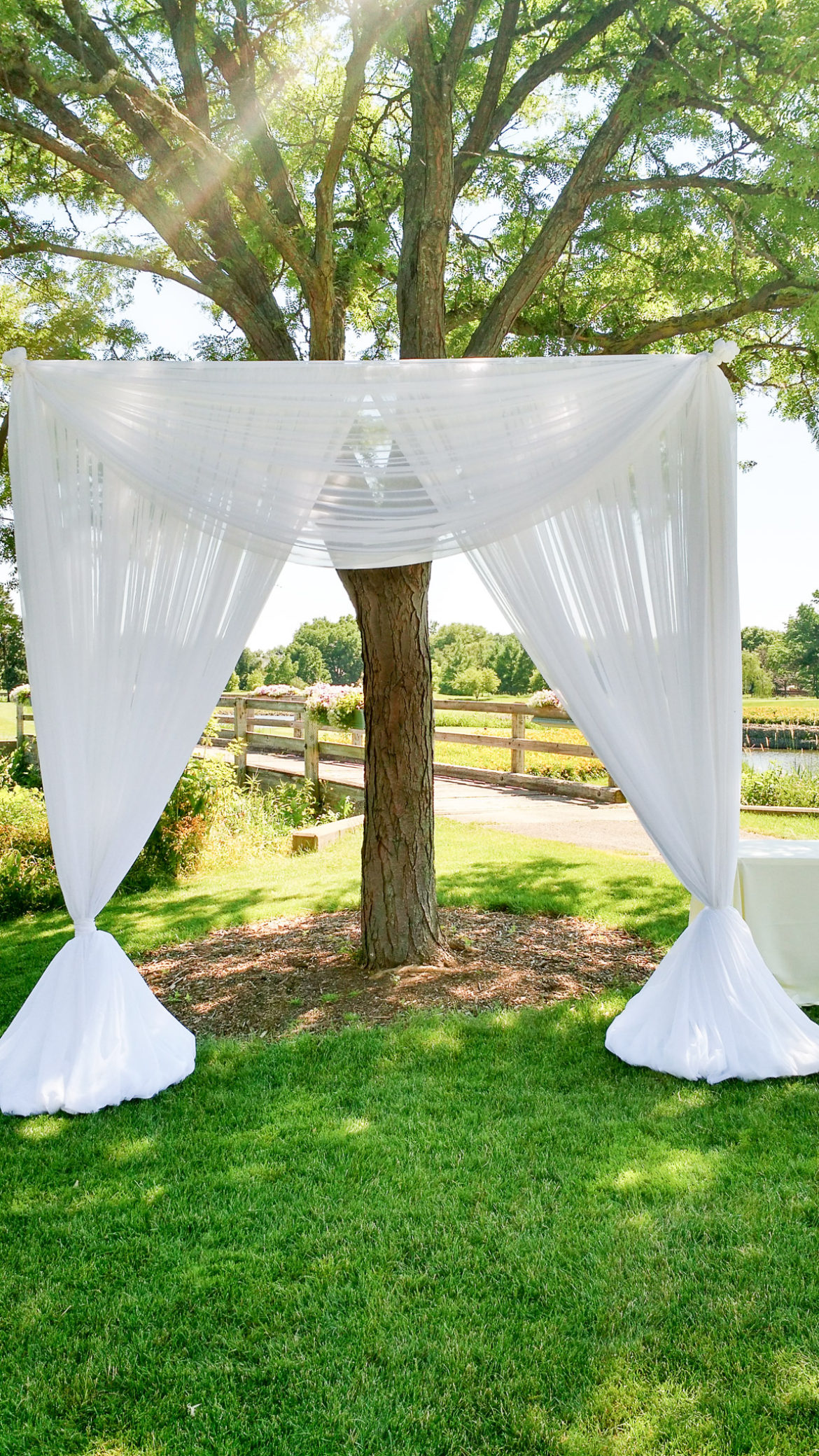 Elegant_Event_Lighting_Chicago_Seven_Bridges_Wedding_White_Bridal_Canopy_Arch_Draping_Outdoor_Ceremony
